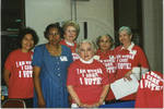 Group of women wearing 'I Am Woman, I Care, I Vote!' shirts by Author Unknown