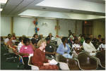 Group at meeting, image 1 by Author Unknown
