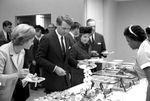 Bobby Kennedy at reception buffet: Image 2 by Edwin E. Meek