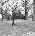 Doug Aberham walking across campus: Image 1 by Edwin E. Meek