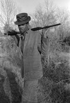 African American man with shotgun, image 003 by Martin J. Dain (1924-2000)