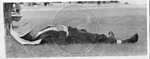 Unidentified man sleeping on the grass by Sidna Brower Mitchell