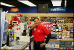 Clerk at Double-Quick Convenience Store [West Jackson Avenue] by Robert Caldwell
