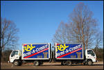 Baby Trucks [Oxford East Shopping Center] by Robert Caldwell