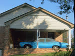 Car in Carport by Duvall Osteen