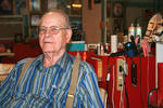 Aaron Holder, Barber for 44 Years [Clip, Snip, and Curl] by Eva Walton