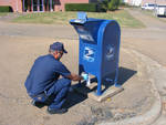 Painting the Mailbox by Roy Button